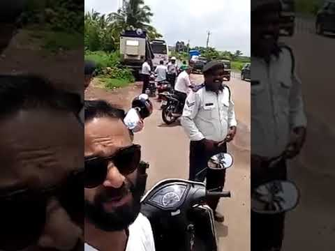 Goa traffic police and without helmet person