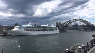 Storm over Sydney Harbour while Cruise ship Rahpsody of the Sea departs