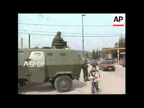 BOSNIA: PALE: NATO TROOPS SURROUND GOVERNMENT BUILDINGS
