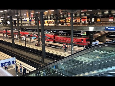 DEUTSCHE BAHN Multi-level platforms and retail shops at Berlin's Hauptbahnhof main station