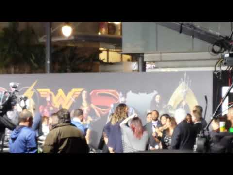 Jason Momoa  (Aquaman) and Ray Fisher (Cyborg) goof around on Batmobile at Justice League premiere