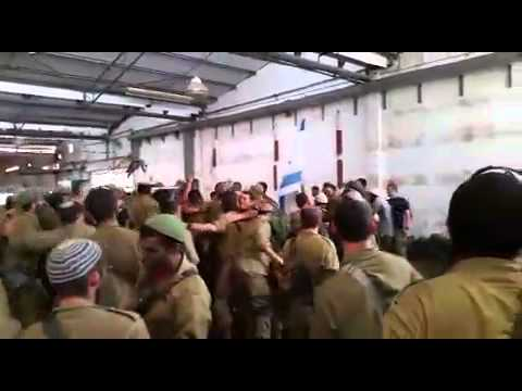 IDF soldiers visited near Gaza during Operation Protective Edge by Chabad Rabbis to boost morale