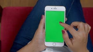 Woman scrolling her mobile, zoom in and out in the green screen