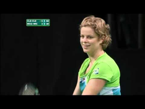 Kim Clijsters threatens to shove a ball down Caroline's Wozn