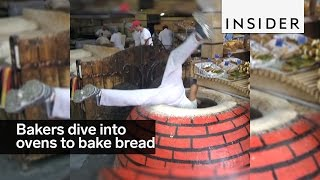 Bakers Dive Into Ovens To Bake Bread