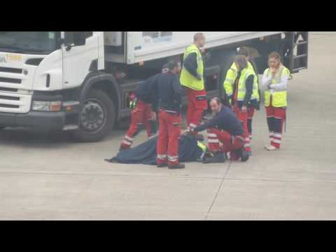 Brussels airport employee knocked down.
