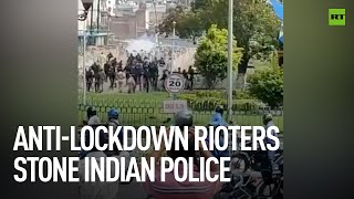 COVID-19   Angry crowd throws stones at police in India