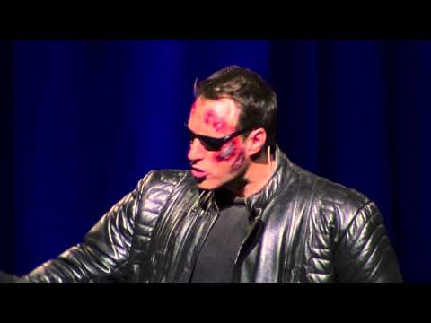 Ben Price Impersonating Arnold Schwarzenegger at the Financial Education Summit 14 June 2013