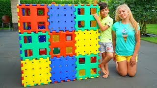 Jason and Family Playing with Toy Blocks