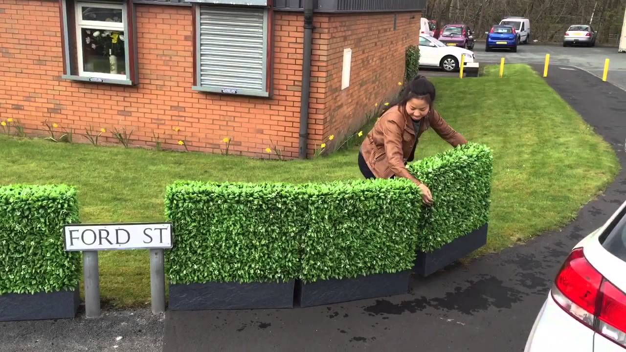 Bespoke artificial hedge building services floral hedge