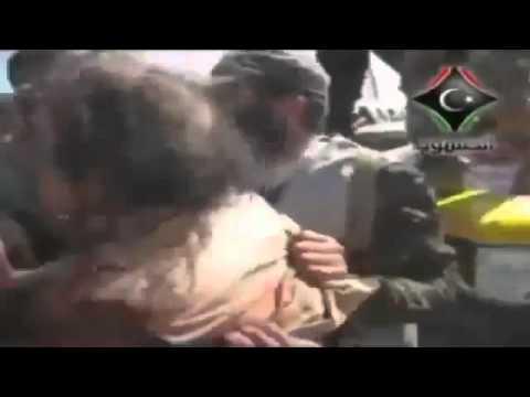 Download KADAFI MOMENTOS ANTES DA MORTE Sendo torturado por rebeldes flv