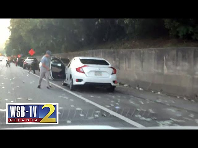 Drivers stop on I-285 to collect cash that fell out of armored truck Video Thumbnail