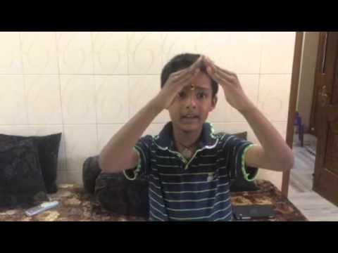 8 year boy reciting a Tamil poem