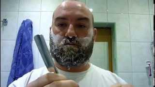 Golenie brody Brzytwą , Razor shaving his beard