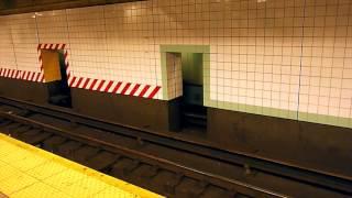 Men at wok in New York Subway