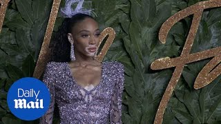 Winnie Harlow poses for pictures at the British Fashion Awards thumbnail