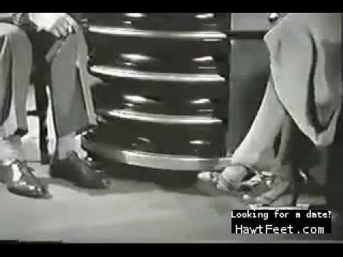 Kay Francis playing with her shoes in Man wanted 1932