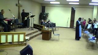 Evangelist Gene Martin singing a medley of gospel greats