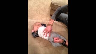 Chiropractic adjustment on an infant