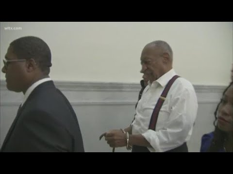 Bill Cosby brought out of court in handcuffs