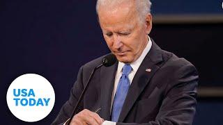 Joe Biden checks his watch during final presidential debate | USA TODAY