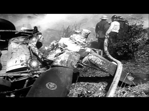 Firemen douse fire and victims are carried out after a B-50 bomber crashed into a...HD Stock Footage