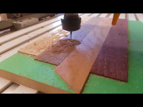 CNC cutting some hardwood puzzle pieces