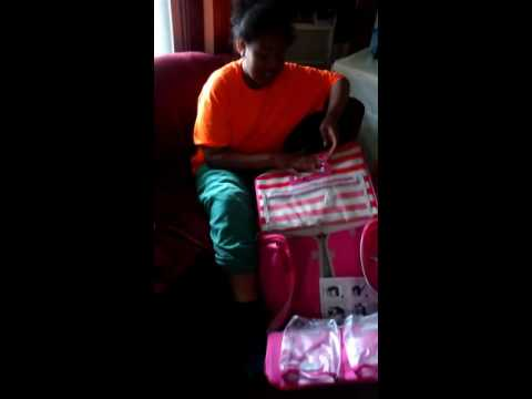 My daughter reviewing her new we r memory keepers 360 crafters rolling bag