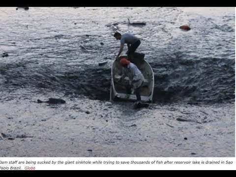 """""""Massive Sinkhole Drains Lake In Brazil Thousands Fish Die 2 Men Almost Lost In Abyss"""""""
