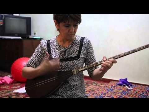 Guzal Muminova plays Dutar