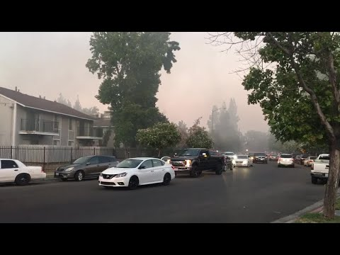 Firefighters battle large apartment fire near Fresno State