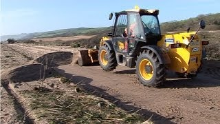 Slapton Sands Road (The Line) 16/02/2014 Is open The big clean up with bulldozers after the storm.