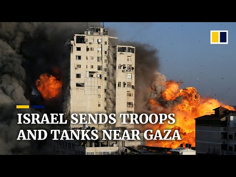 Israel sends ground troops and tanks near Gaza, threatening