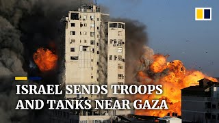 Download Israel sends ground troops and tanks near Gaza, threatening to open a new front in the fighting