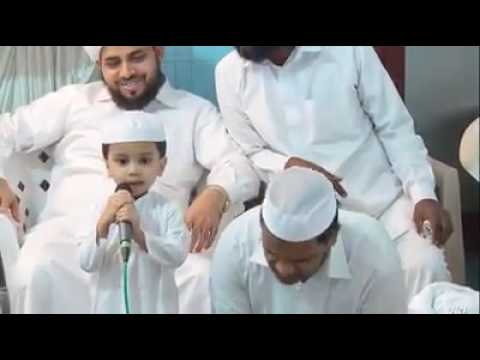 A small baby hi singing NAFEESATH MALA  in front of shaik aboobaker bin ahmad