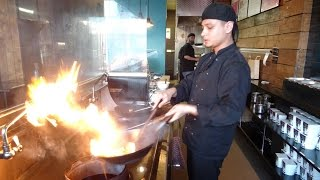 Delicious Pan Asian Street Food: Tofu, Brown Rice & Mixed Veg And Madras Sauce Stir Fry At Wok Wala