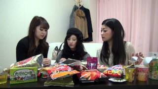 Japanese girls are comparing the tastes of convenience store snacks.