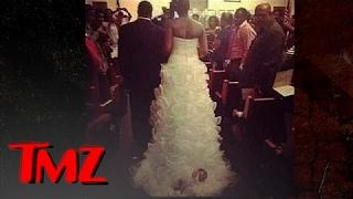 Baby Tied To A Wedding Dress?! | TMZ