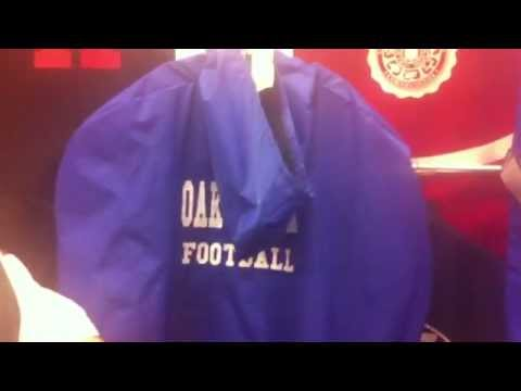 "RALLY ATHLETIC BAGS Showed off its custom-made ""no- theft"" football rain jackets at the AFCA Conv."