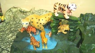 Животные. Динозавр похитил детеныша . Игрушки