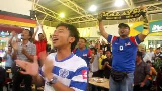 Esctatic Malaysia footballs fans cheered and sings Patriotic song
