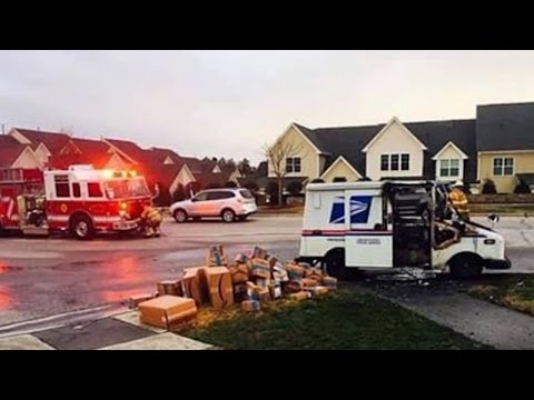 Thumbnail: Watch Postal Worker Save Holiday Packages From Burning In Mail Truck Fire