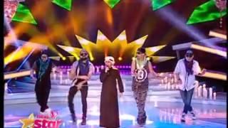 """بالدشداشة والغترة..عمر أرناؤوط يغني """"بشرة خير"""" لحسين الجسمي في رومانيا"""