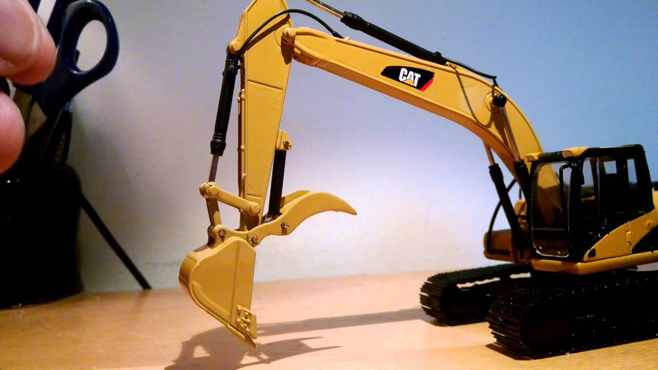 Excavator with construction thumb