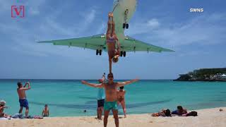 A Couple Posed for A Daring Photo Under A Plane That Was Landing