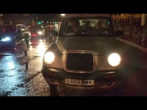 London taxi, LS05 MWK, being asked to leave the cycle lane ...