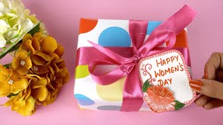 Top view shot of beautiful flowers and women's day present - pink background
