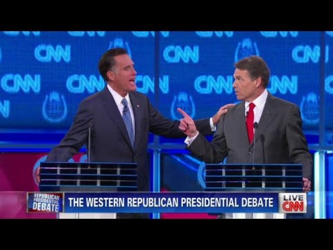 Perry accuses Romney of hiring illegals
