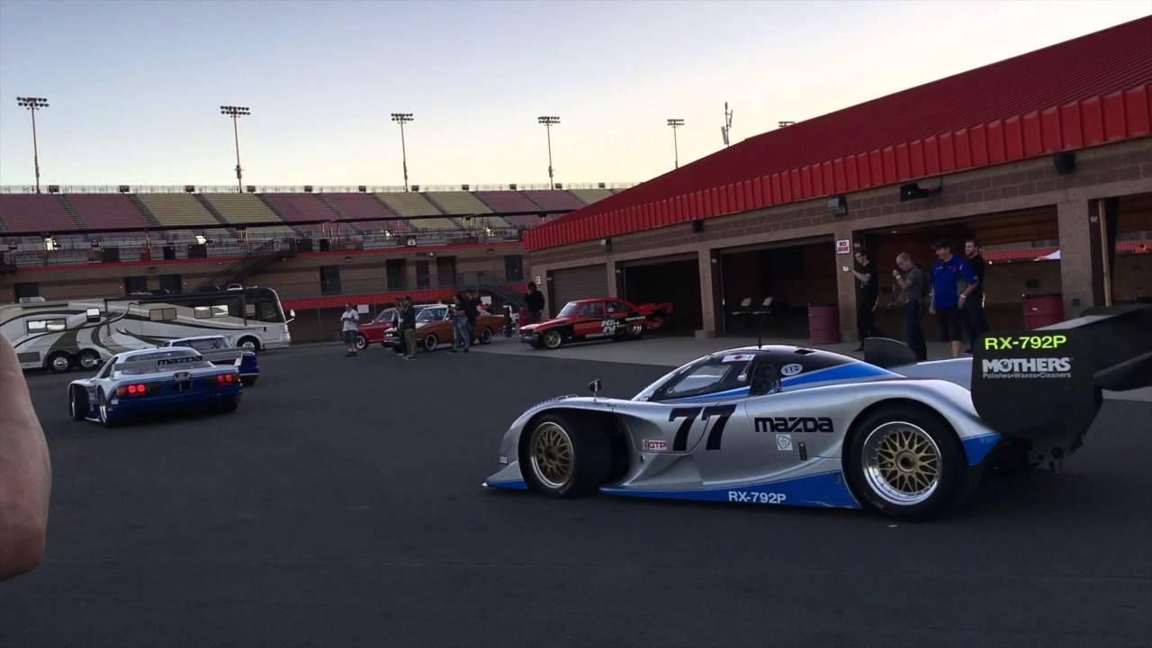 Mazda factory race cars leaving paddock for demo run at Sevenstock ...