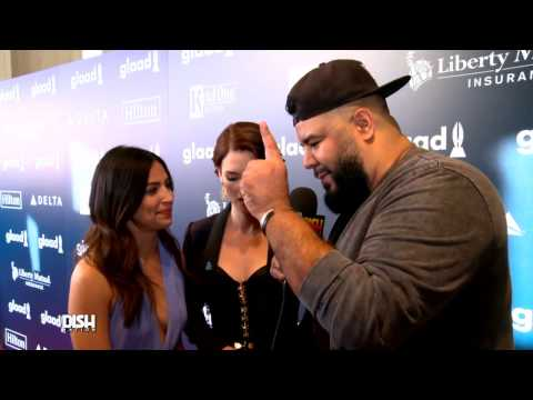 Floriana Lima & Chyler Leigh Dish At The Glaad Awards About Their Supergirl Kiss With Kevin Smith